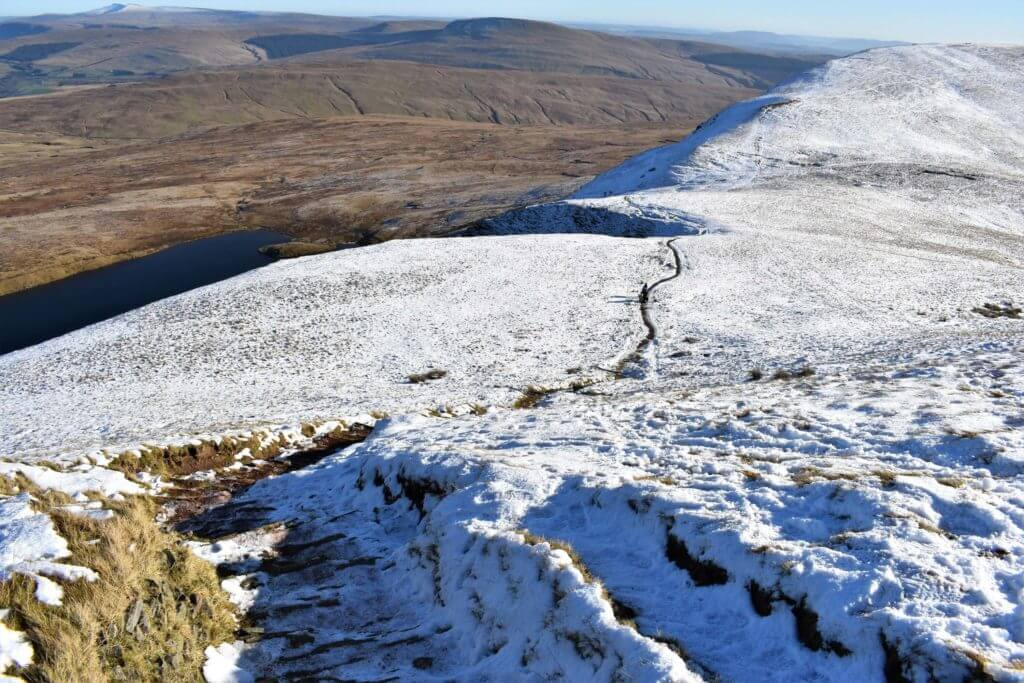 the trail drops away from the summit of Fan Brycheiniog