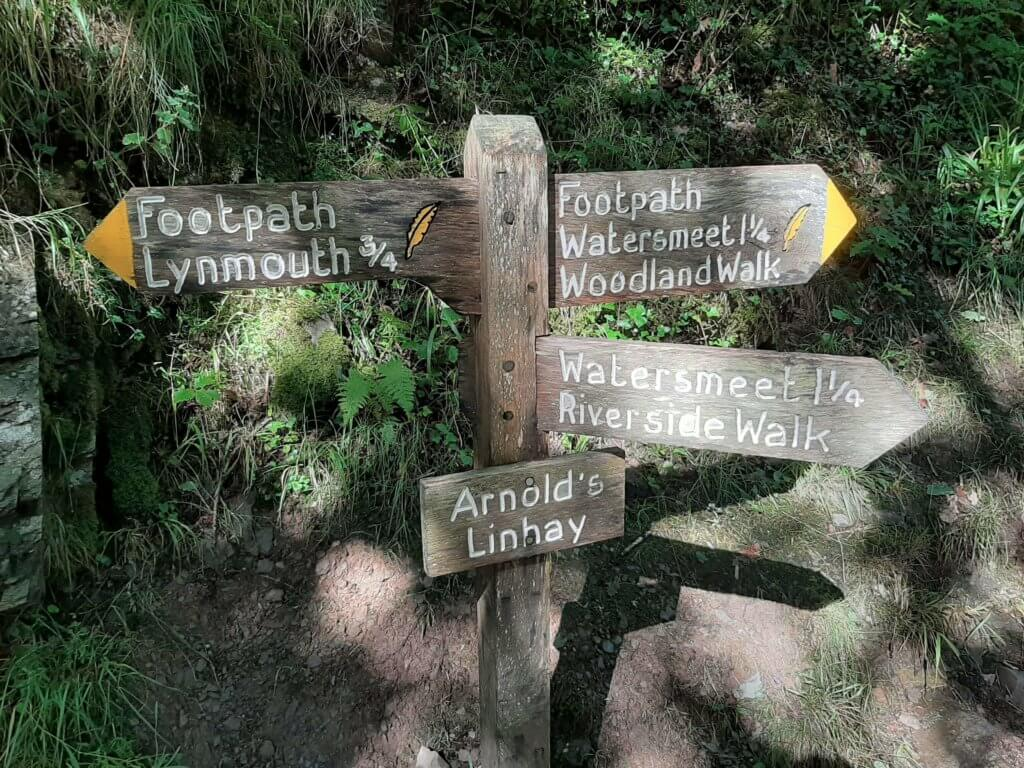 wooden signpost on the watersmeet trail