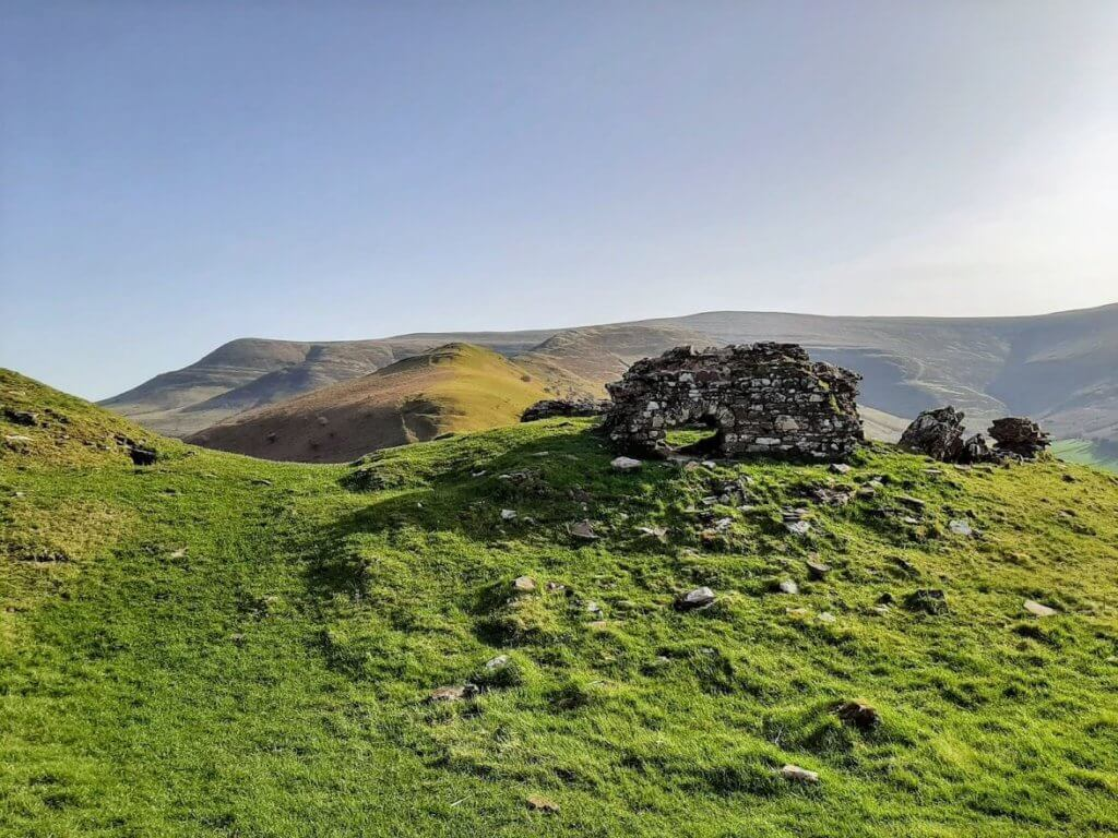 ruins of Castell Dinas and the Dragon's Back behind