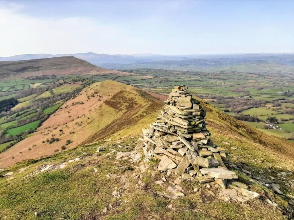 pointed stone cairn on the waun fach walk