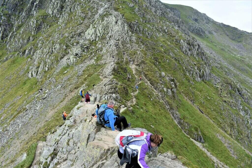 hikers making their way along striding edge