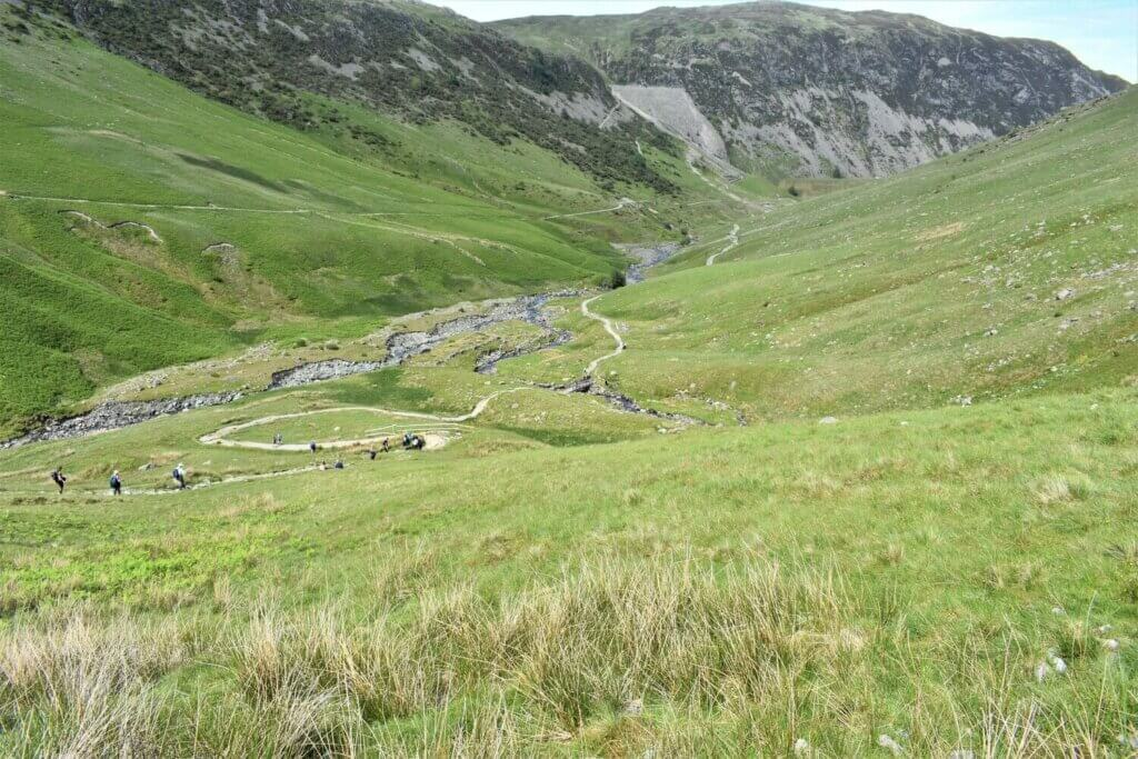 the helvellyn walk route winds its way into the valley