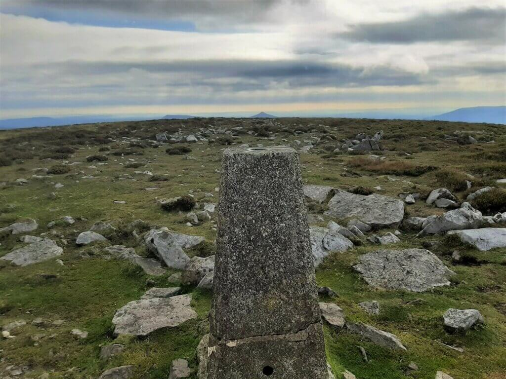 pen cerrig calch trig point with sugarloaf in the background